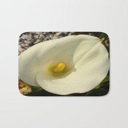 Single Cream White Calla Lily With Garden Background Bath Mat