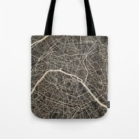 paris map Tote Bags featuring Paris map by NJ-Illustrations