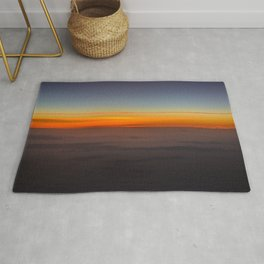Sunrise over clouds Rug