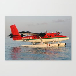 Sea Plane at Sunset in the Maldives Canvas Print