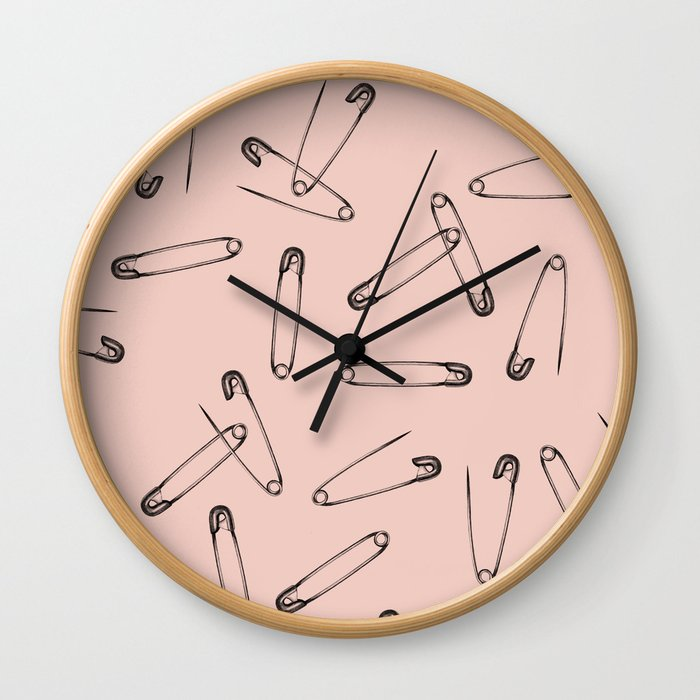 Pink safety pin Wall Clock