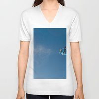skiing V-neck T-shirts featuring Skiing off a jump by Dustin Hall