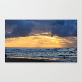 Cloudy Sunset on sea shore Canvas Print