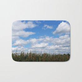 """Corn field in autumn with """"popcorn"""" clouds Bath Mat"""