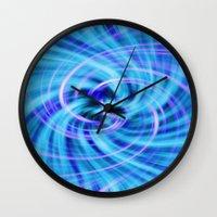 pivot Wall Clocks featuring Blue twirl by AvHeertum