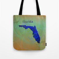 florida Tote Bags featuring Florida Map by Roger Wedegis