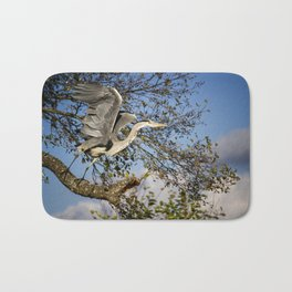 Grey Heron taking flight Bath Mat