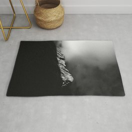 Last sun rays on the mountain in black and white Rug