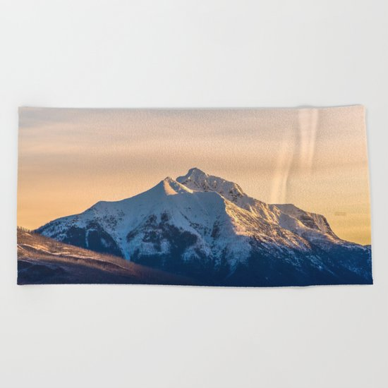 The Rising Mountain Beach Towel