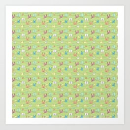 Colorful bunnies on green background Art Print
