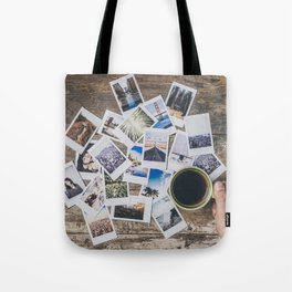 Polaroids prints on a wooden table Tote Bag