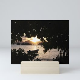 Sunset framed by leafs Mini Art Print