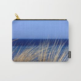 Dried long grass with blue sea behind and blue sky Carry-All Pouch
