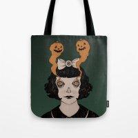 alisa burke Tote Bags featuring jack o lantern eyes by Ally Burke