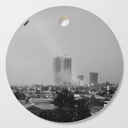 Smoke in the city Cutting Board
