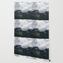 Clouds covering mountains Wallpaper