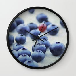 Blue berries with one red currant Wall Clock