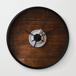 Flatlay brown wood floor and cup of black coffee in a white cup Wall Clock