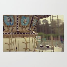 Carousel in the amusement park Rug