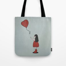 Girl with a Heart-Shaped Balloon Tote Bag