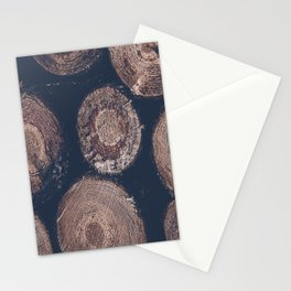 Cut tree trunks in forest, dark and moody fine art photography Stationery Cards