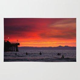 Surfers watching Sunset Rug