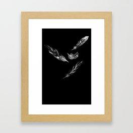 Feathers on black Framed Art Print