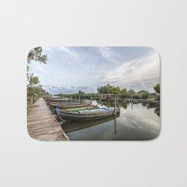 Boats in a lagoon port Bath Mat