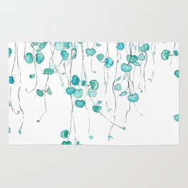 string of hearts watercolor Rug