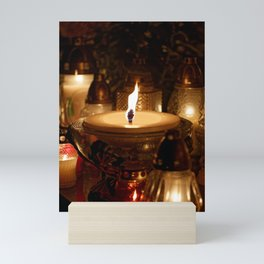Candles Burning At a Cemetery Mini Art Print