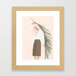 Holding a Palm Leaf Framed Art Print