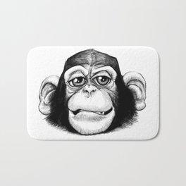Cheeky baby chimp black and white. Bath Mat