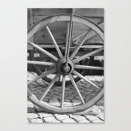 Old wooden cart wheel Canvas Print
