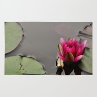 lotus flower Area & Throw Rugs featuring Lotus by Stevyn Llewellyn