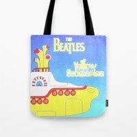 yellow submarine Tote Bags featuring submarine by Emma Kennedy