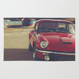 Triumph spitfire, english car by the beach in italy, old car and a boat, for man cave decor Rug