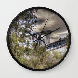Shipwrecked at sunset Wall Clock