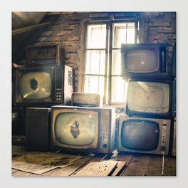 Old televisions in a dusty attic Canvas Print