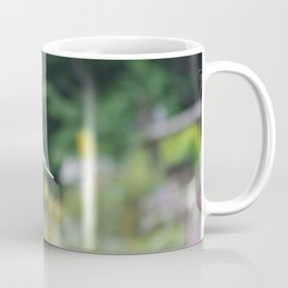 Feather falling gently Coffee Mug