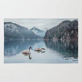 Swans on the Apsee lake, Bavrian alps Rug
