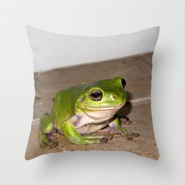 A beautiful green tree frog sitting on tiles Throw Pillow