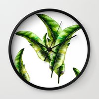 banana leaf Wall Clocks featuring Banana Leaf -watercolor  by craftberrybush