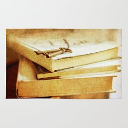antique books and key Rug