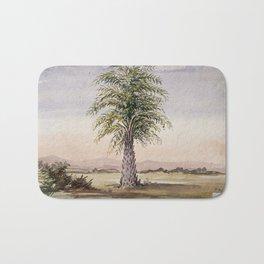 Palm tree (Cocos nucifera) in arid landscape. Watercolour, 1862. Bath Mat