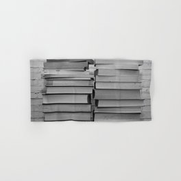 Black and white image of some books stacked on a shelf Hand & Bath Towel