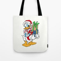 donald duck Tote Bags featuring Donald Duck with christmas gifts by Yuliya L