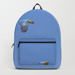 Blue macaws flying under blue sky Backpack
