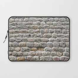 Close up view of the textured stone wall of a historical building Laptop Sleeve