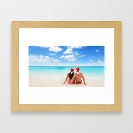 Christmas beach vacation couple relaxing in santa hats on Caribbean holidays Framed Art Print
