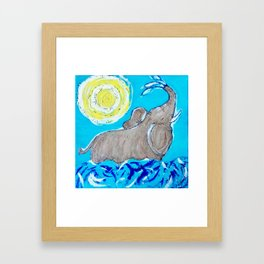 Baby Elephant Playing in the Water Framed Art Print